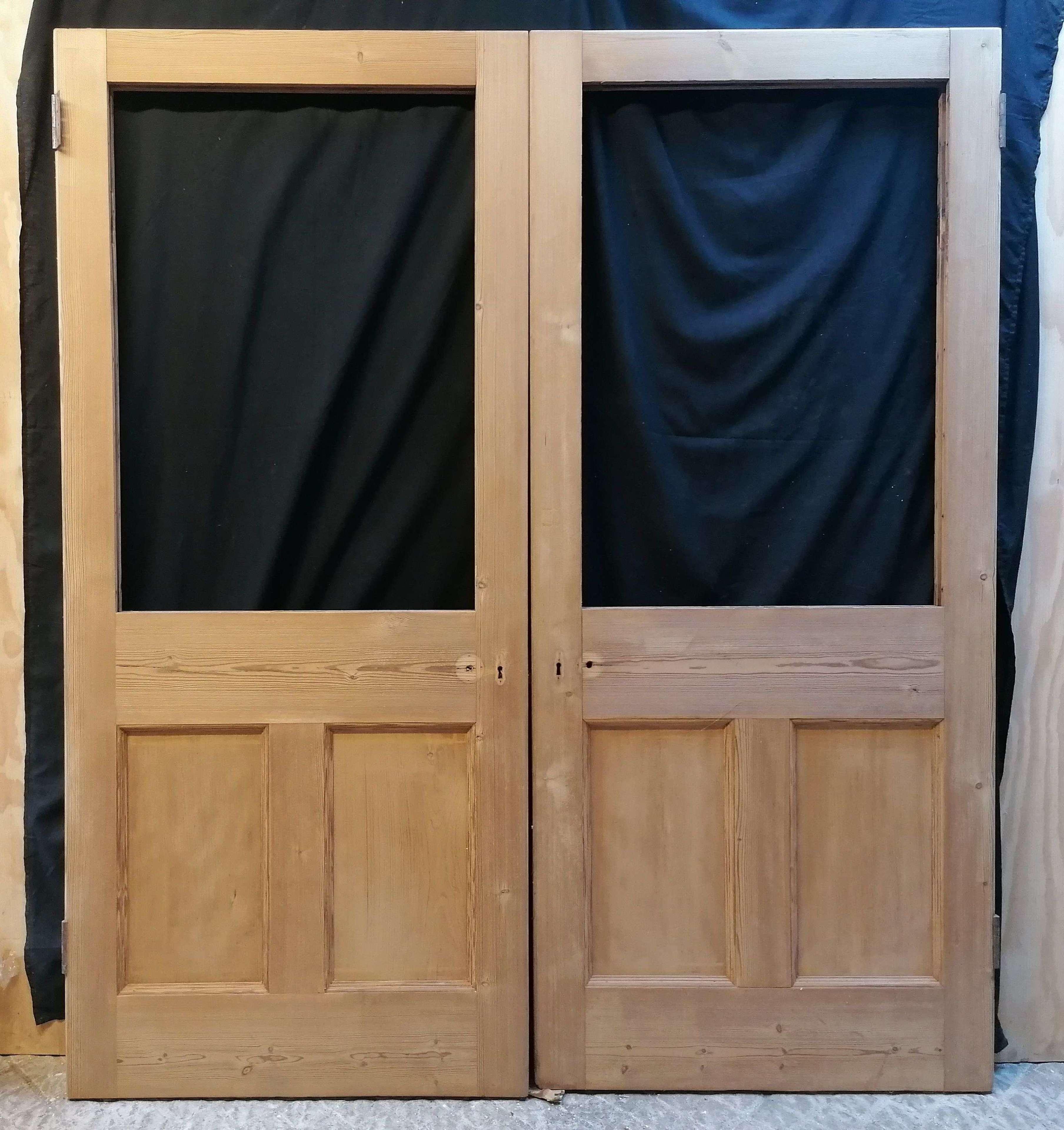 DP0338 A PAIR OF RECLAIMED VICTORIAN INTERNAL STRIPPED PINE DOORS