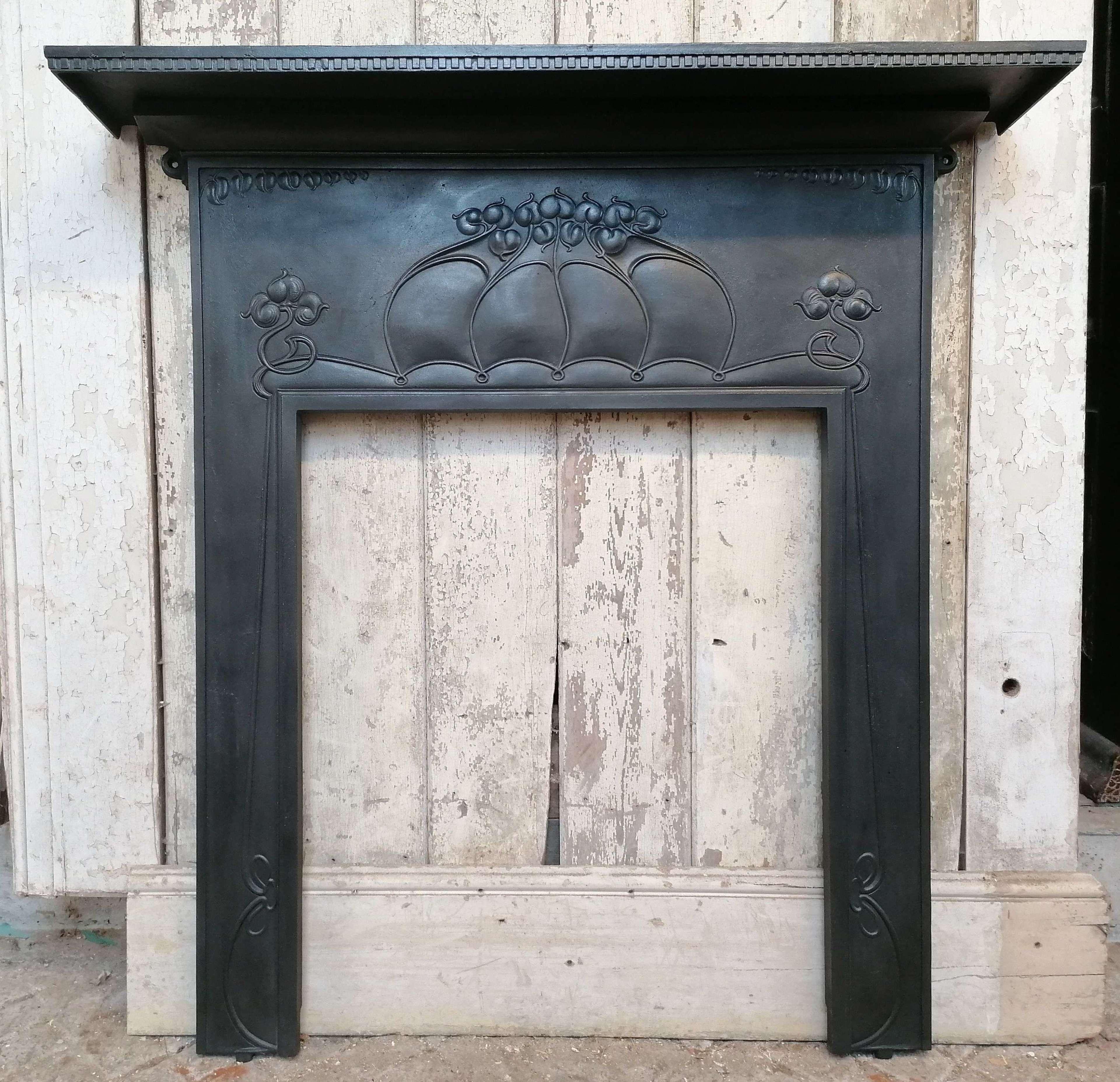 FS0162 A DECORATIVE RECLAIMED ART NOUVEAU CAST IRON FIRE SURROUND